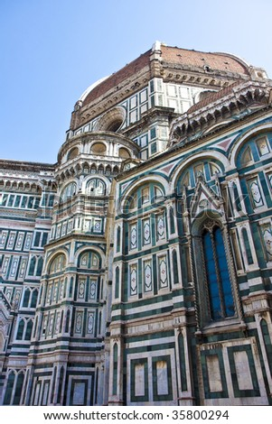 The Il Duomo church in Florence, Italy with details and window - stock photo