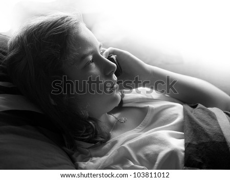The ill girl calling with her mobile phone. Child abuse concept. - stock photo