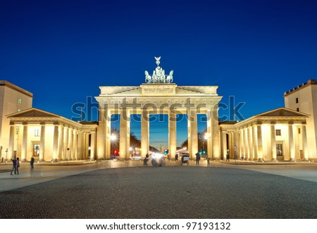 The illuminated Brandenburg Gate at dawn - stock photo