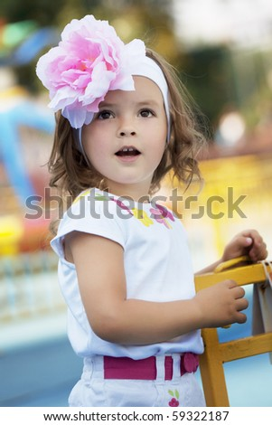 The image of a beautiful baby girl surprised - stock photo
