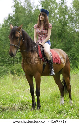The image of a beautiful brunette girl with horse - stock photo