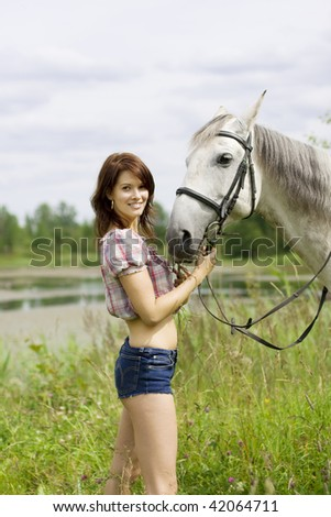 The image of a beautiful brunette girl with horse