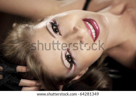 The image of a beautiful girl with a bright luxurious makeup - stock photo