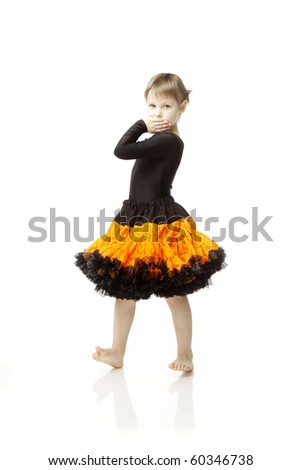The image of a beautiful little girl in a bright skirt with a white background - stock photo