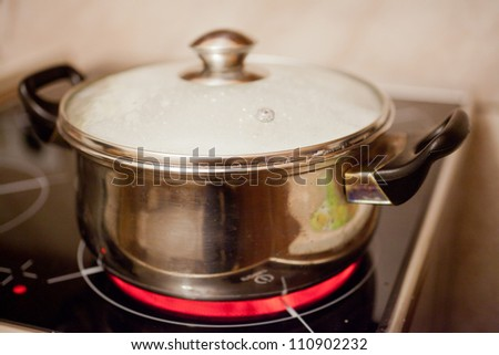 The image of a pan on electric stove - stock photo