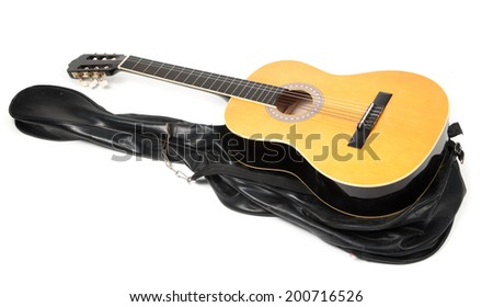 The image of acoustic guitar in a case - stock photo
