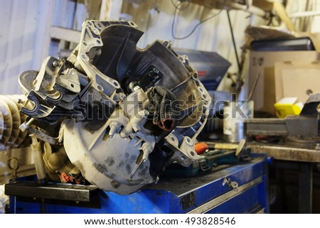 The image of an unassembled transmission in repair station