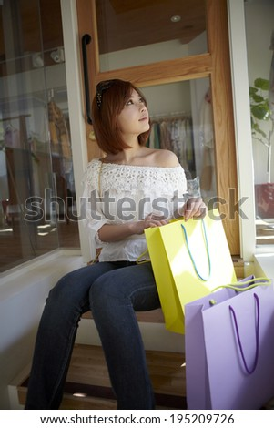 the image of Asian woman with shopping bags