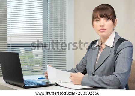 The image of business woman in an office