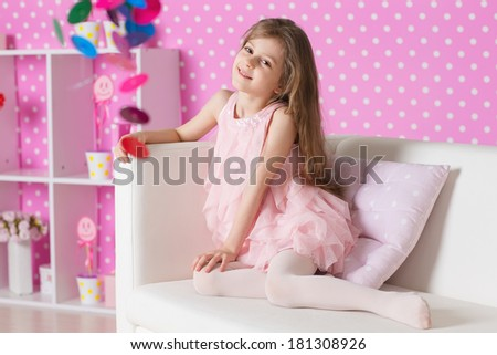 The image of child in the nursery in pink dresses - stock photo