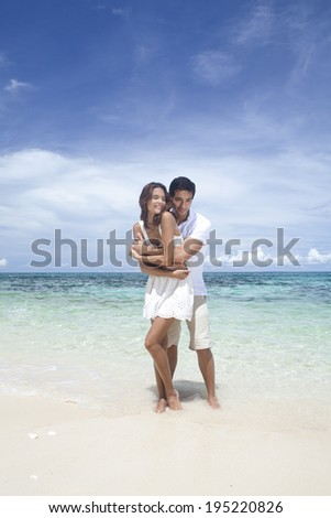 the image of couple by the sea in Boracay in the Philippines