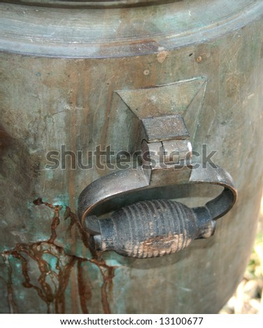 The image of detail of old cooper samovar - stock photo