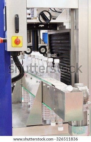 The image of food industry equipment for plastic bottles