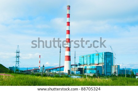 The image of power station against a summer landscape - stock photo