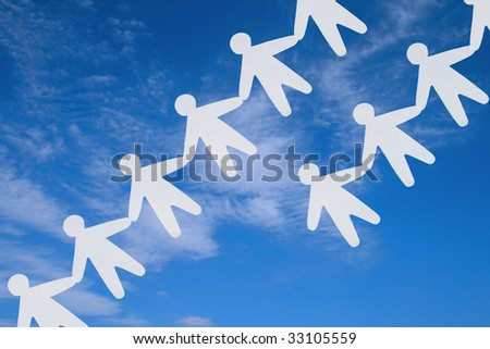 The image of silhouettes of the people keeping for hands on a background of the sky. - stock photo