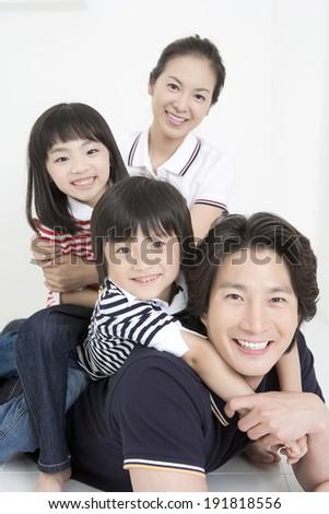 The image of smiling family in Korea,Asia - stock photo