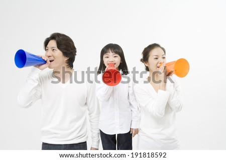The image of smiling family in Korea,Asia with loud speaker