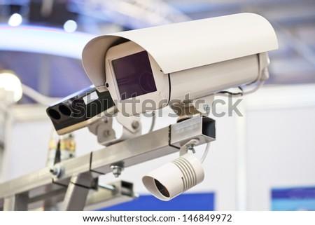The image of surveillance camera - stock photo