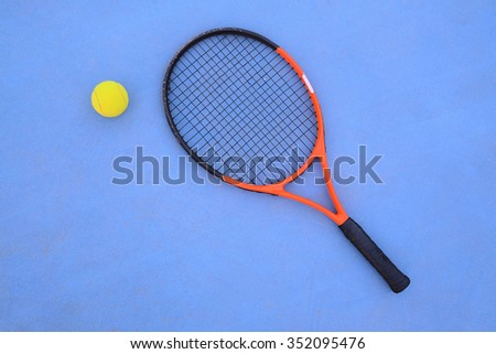 The image of tennis ball and tennis racket - stock photo