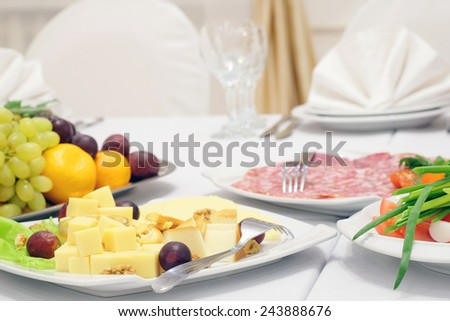 The image of the dishes and food on the served table  - stock photo
