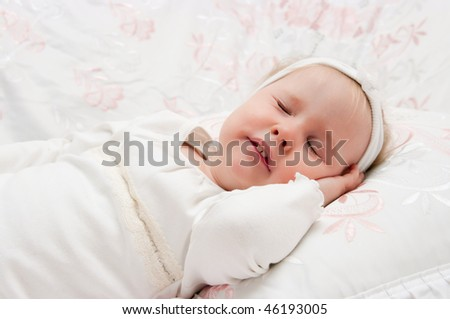 The image of the little girl, gathering to sleep on lacy bed - stock photo