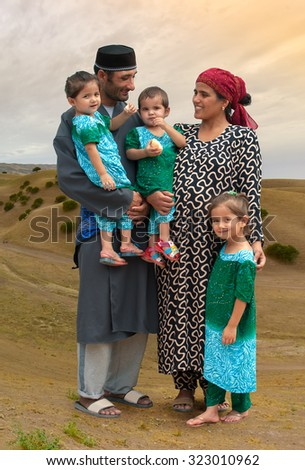 The image of the Tajik family in the background hills