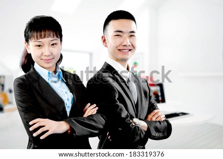 The image of the two young business people in the office - stock photo