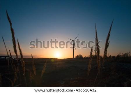 The image of windmill, sunset, energy - stock photo