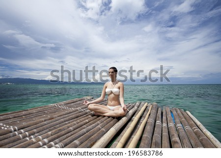 the image of woman doing Yoga