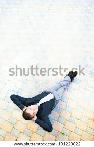 The image on top of a businessman sitting in the street, which has a success.