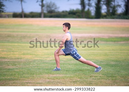 The image with a man going exercises in a park