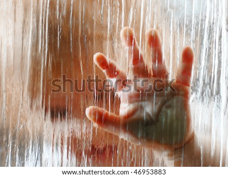 The imprint of children's hands on the window - stock photo