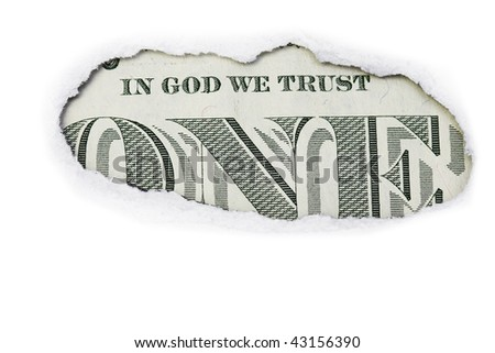 """The """"In God We Trust"""" area on the back of a one dollar bill in a white torn paper. - stock photo"""