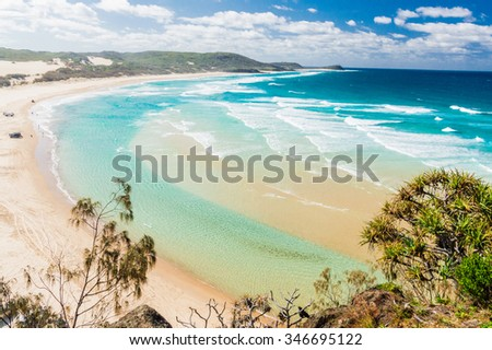 The incredible stretch of Fraser Island's sandy beach - stock photo