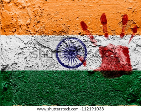 The Indian flag painted on grunge wall with bloody palmprint over it