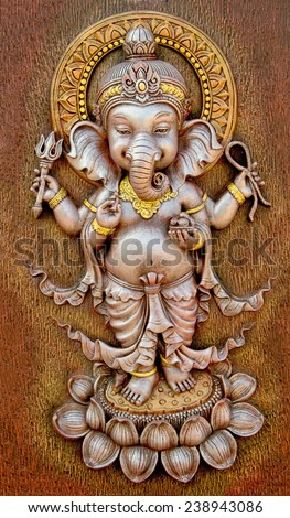 The Indian God Ganesha made from clay in low relief carving  - stock photo