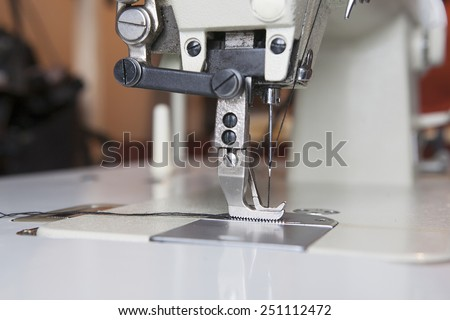 the industrial sewing machine sewing machine closeup - stock photo