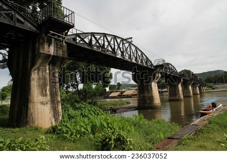 The infamous Bridge over the River Kwai constructed during World War II in the town of Tha Ma Kham, Kanchanaburi, Thailand. - stock photo