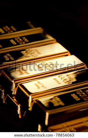 The ingots of gold combined by a pyramid - stock photo