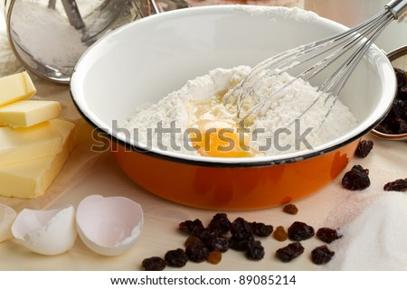 The ingredients for baking cupcake with raisins - stock photo