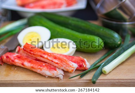 The ingredients to make the salad - crab, cucumber, egg, onion. Selective focus - stock photo