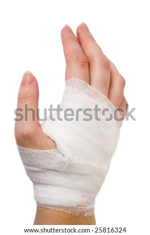 The injured hand of the girl tied up by white bandage