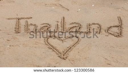 The inscription on the sand Love Thailand - stock photo