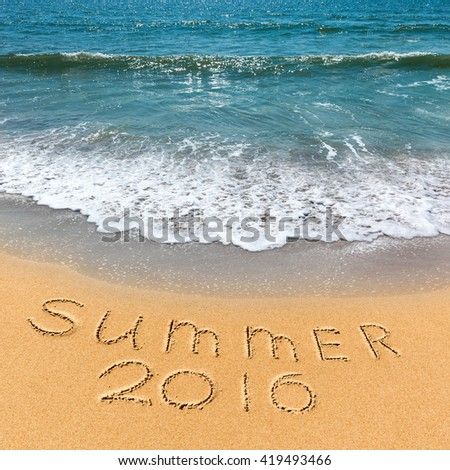 the inscription on the sand summer vacation on the beach - stock photo
