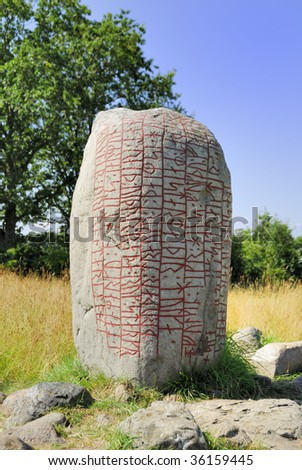 The inscription on this Rune Stone tells that a Danish Chieftain is buried here. He died on the way back to Denmark and was buried on this spot on Oeland. - stock photo