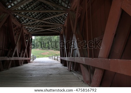 The inside beauty of the Campbell covered bridge in South Carolina, USA. Enjoy a look through the 1909 architecture to the summer day at the end of the bridge. horizontal format