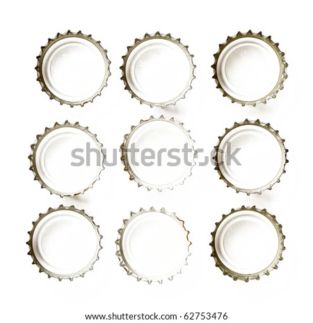 the inside of bottle caps isolated on white - stock photo