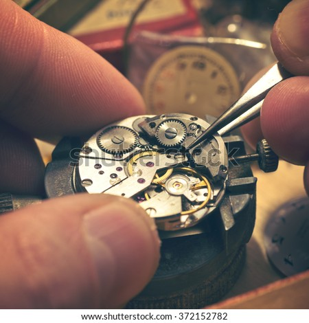 The inside workings of a vintage mechanical watch. - stock photo