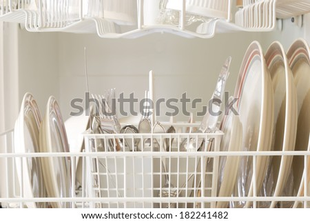 The interior of a dishwasher after a clean cycle - stock photo