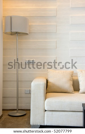 The interior of a modern home, couch and pillow detail. - stock photo